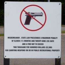 WHAT'S UP WITH THAT: No guns allowed signs