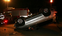 Impaired driver trapped in flipped vehicle