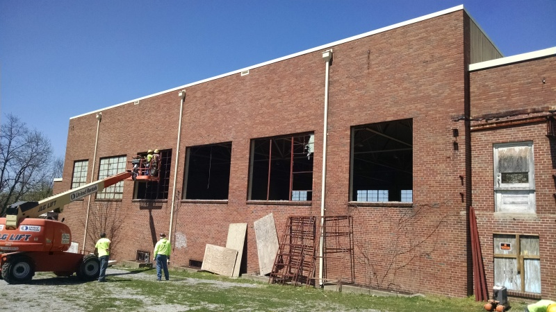 Old Franklin High gym windows will give new supermarket vintage look