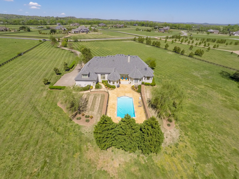 SHOWCASE HOME: 10 acres, a pool, and a natural view set Two Rivers house apart