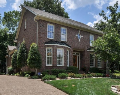 SHOWCASE HOME:  Renovated brick home in park-like setting